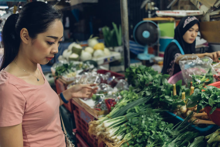 Young woman looking at market stall