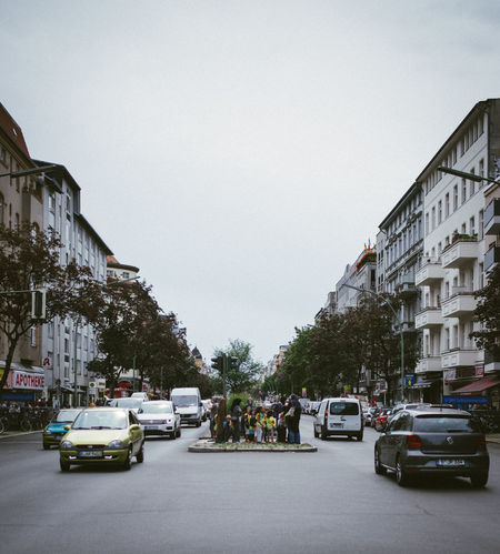 A group of people waiting to cross the boulevard Berlin Building Exterior Capture Berlin Car City City Life City Street Day Deutschland Germany Mode Of Transport Outdoors Road Sky Street Street Crossing Symmetry Traffic Transportation Tree