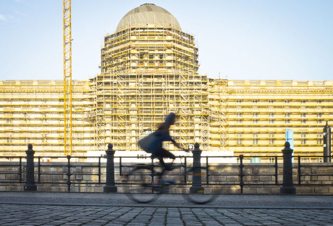 Architecture Built Structure Building Exterior City Bicycle Blurred Motion Motion Riding Ride One Person Sky Real People Transportation Lifestyles Activity Building Sport Nature Street Outdoors Office Building Exterior