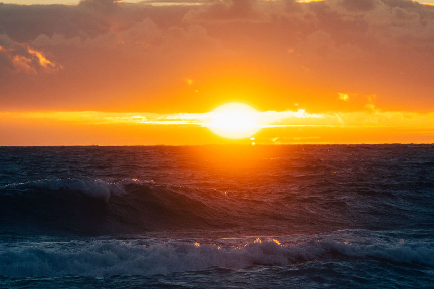 Sunset Sea Dramatic Sky Orange Color Horizon Over Water Beauty In Nature Sun Nature Sunlight Horizon Scenics No People Summer Tranquility Romantic Sky Outdoors Beach Sky Day