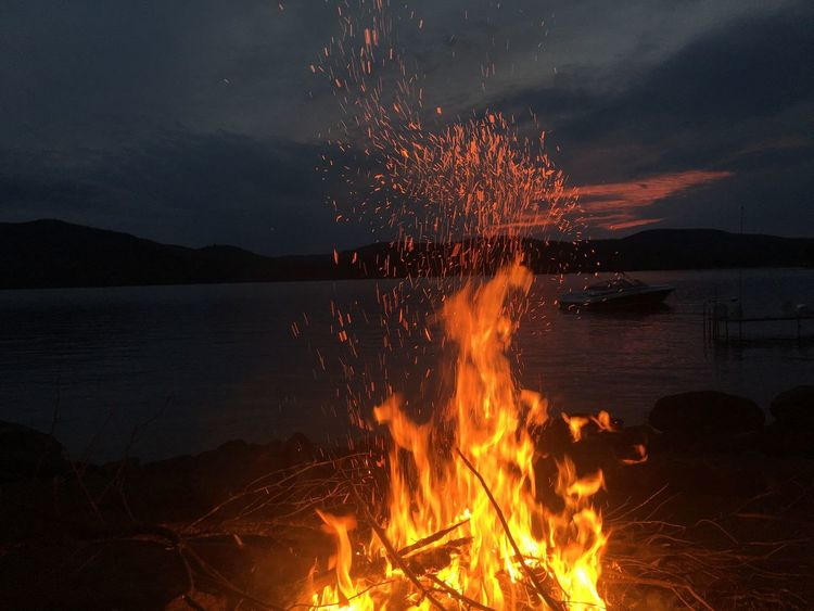 Flame Burning Nature Sky Heat - Temperature Beauty In Nature Night Glowing Outdoors Sunset Bonfire Motion Campfire No People Scenics Sea Silhouette Water Beach Long Exposure