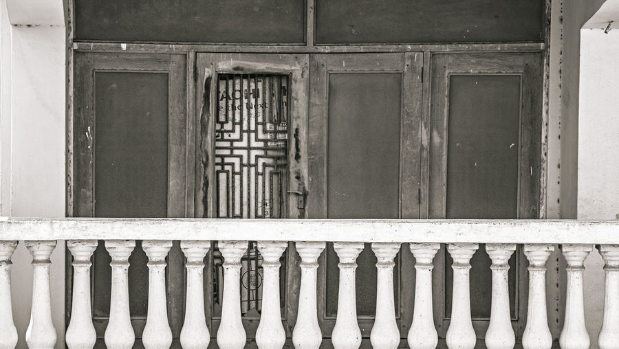 Odd Odd One Out Abandoned Architecture Built Structure Window No People Day Building Exterior Safety Building Security Metal Closed Protection Outdoors Old Barrier Side By Side Balustrade Wood - Material Pattern