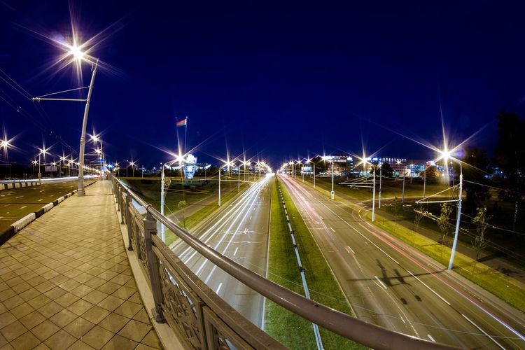 Belarus Minsk Architecture City Illuminated Lighting Equipment Mode Of Transportation Motion Night No People Outdoors Road Street Street Light Transportation
