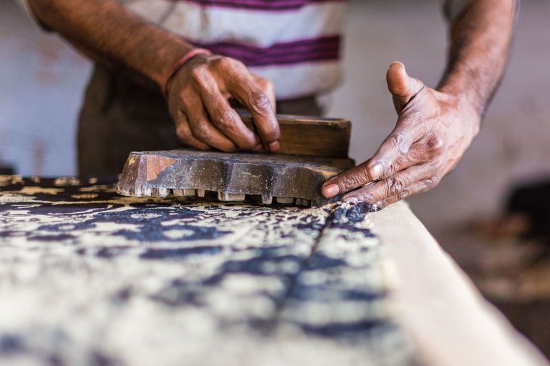 Human Hand Hand One Person Occupation Human Body Part Selective Focus Real People Working Wood - Material Skill  Preparation  Indoors  Craft Holding Art And Craft Close-up Workshop Midsection Table Preparing Food Chisel