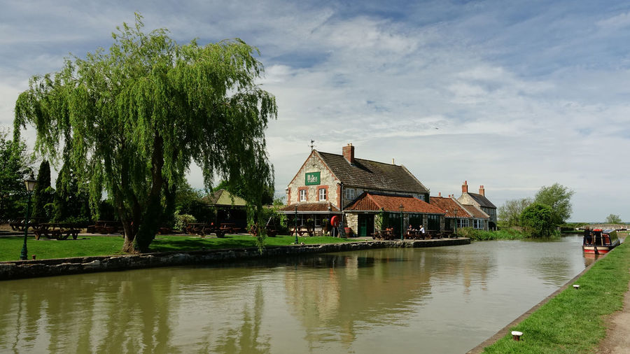 On the Kennet and Avon Canal Barge Inn Beauty In Nature Building Exterior Built Structure Cloud - Sky Day Kennet And Avon Canal Nautical Vessel No People Outdoors Seend Cleeve Sky Tree Waterfront