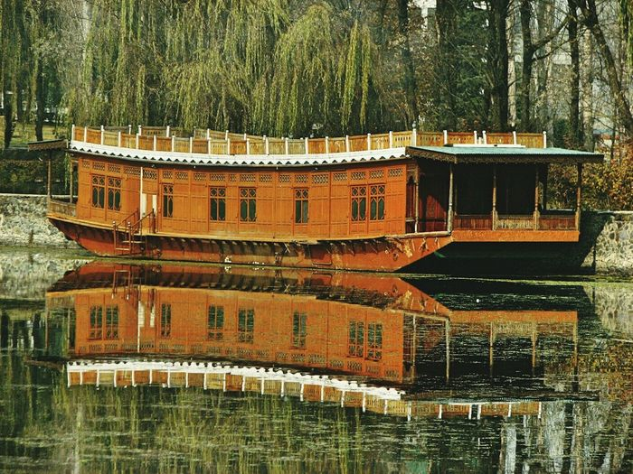 Shikara On Dal Lake With Reflection