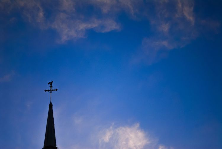 Sky Cloud - Sky Low Angle View Blue Religion Belief Built Structure Tower Nature Spirituality Place Of Worship Building Weather Vane Cross Outdoors Architecture Building Exterior No People Spire