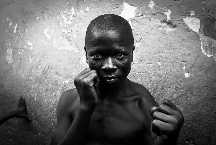 Accra Boxer Documentary Photography Fear Fearless Ghana Jamestown The Week On EyeEm Africa Day To Day Blackandwhite Documentary Hard Life Human Hand Insecure Looking At Camera Monochrome Old Face Portrait Reportage Shaved Head Social Issues Street Boxing Streetphoto_bw Streetphotography Young Adult EyeEm Ready