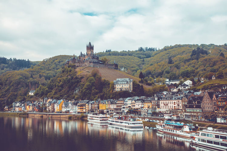 View to the city and castle of Cochem over the river Mosel, Rheinland-Pfalz, 3rd May of 2019. Germany Mosel Building Exterior Architecture Built Structure Water Building Sky City Nature Nautical Vessel Transportation Day Mode Of Transportation No People Outdoors Cochem Cochem An Der Mosel Cochem Castle Cloud - Sky River Waterfront Residential District Harbor Tree Passenger Craft Tower