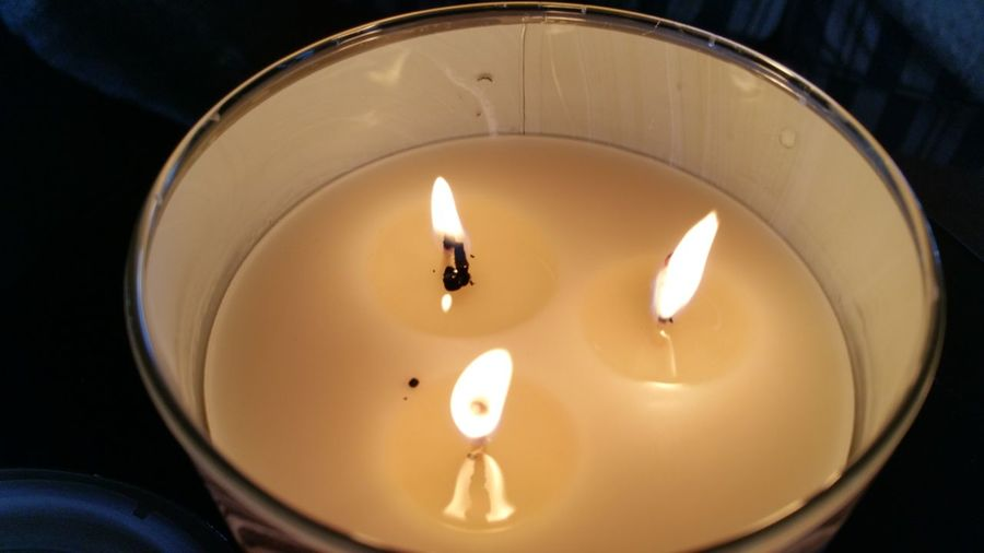 Candlelight Golden Glow Golden Glow Glowing Three Wicks Melting Round Metal Circle Zen Elegant Copy Space Delicate Scent Scented Candle Relaxing Aromatic Therapeutic EyeEm Selects Candle Flame High Angle View Illuminated Glowing Burning Heat - Temperature Tranquility Spirituality Close-up