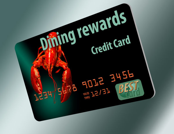 A dining rewards credit card is seen here isolated on a white background. Bank Card Credit Card Diners Credit Card Dining Rewards Car Dining Rewards Credit Card Food Isolated White Background Restaurant