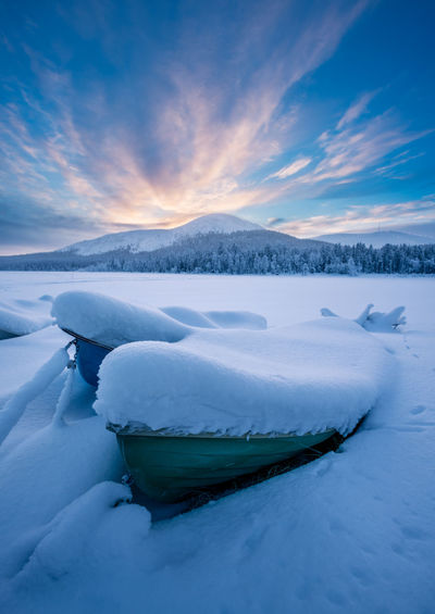 Boats covered by heavy snow with kellostapuli and Ylläs fell in the background in Äkäslompolo, Kolari, Finland Cold Temperature Winter Snow Frozen Tranquil Scene Ice Sky Tranquility Beauty In Nature Scenics - Nature Water Cloud - Sky No People Nature Environment Idyllic White Color Day Iceberg Floating On Water Melting Snowcapped Mountain Finland Lapland Ylläs The Great Outdoors - 2019 EyeEm Awards My Best Photo