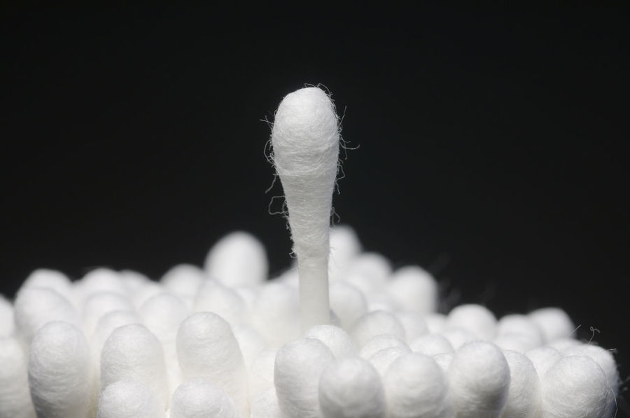 Cotton buds with a single bud raised above the others Black Background Close Up Close-up Concept Cotton Bud Cotton Buds Cotton Swab Hygiene Individuality Many Metaphor No People Object Raised Raising Standing Out Standing Out From The Crowd Sticks Still Life Studio Shot Uniqueness White