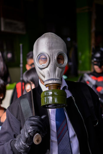Portrait of man wearing gas mask