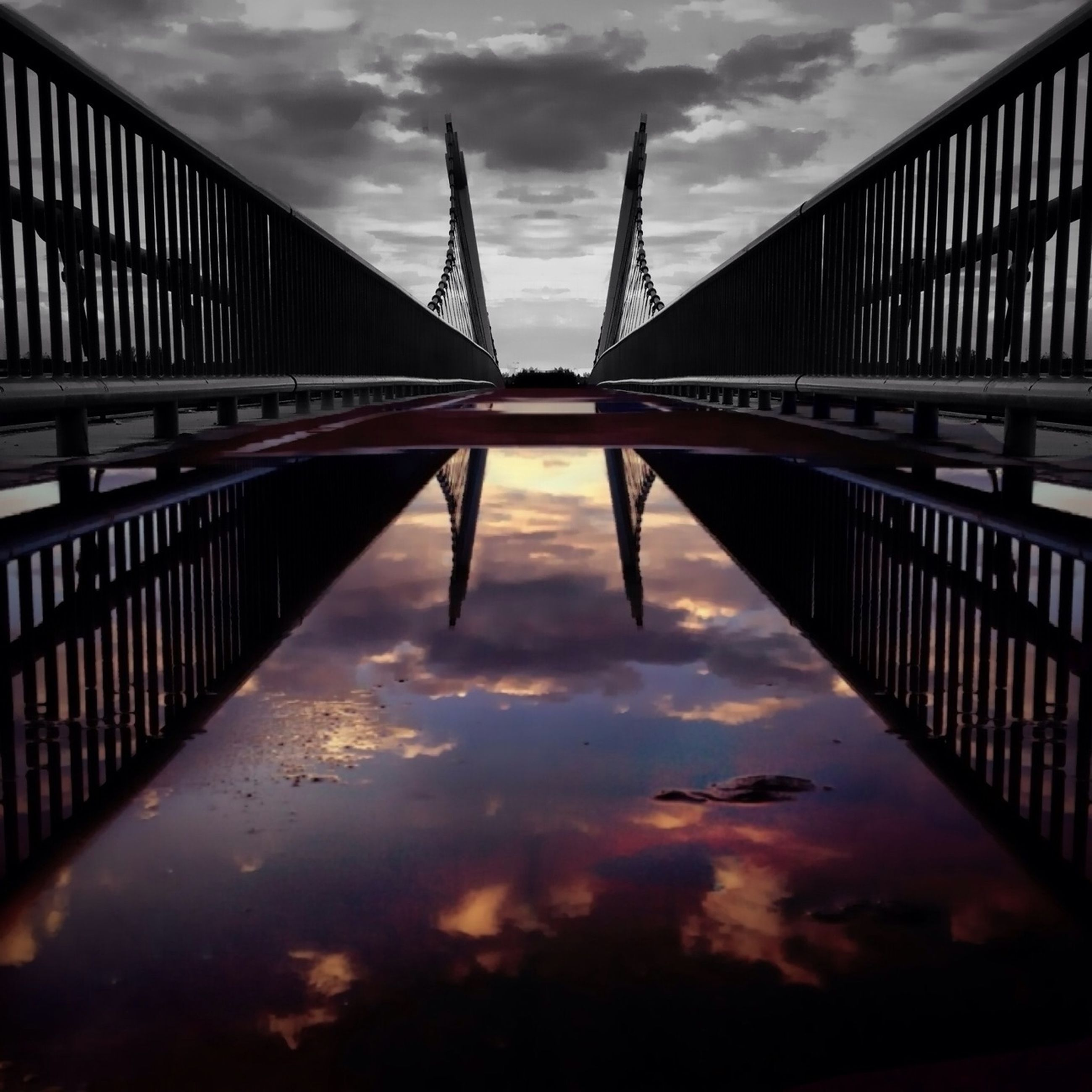 built structure, architecture, bridge - man made structure, sky, connection, cloud - sky, water, low angle view, engineering, bridge, cloudy, reflection, cloud, railing, river, sunset, footbridge, waterfront, outdoors, no people