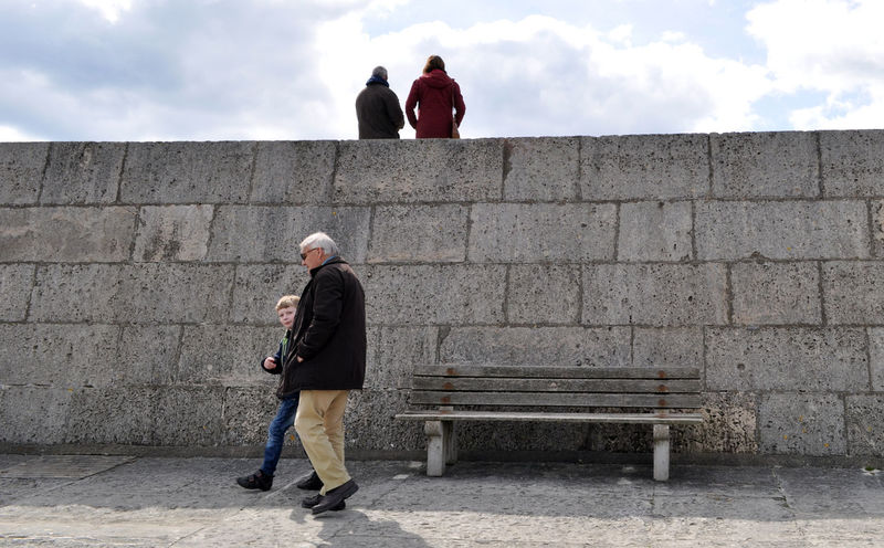 Architecture Bench Built Structure Casual Clothing Cloud - Sky Day Leisure Activity Lifestyles Outdoors People Watching Silhouettes Sky Sunny Day Tourism Travel Destinations Up Close Street Photography Walking Wall People And Places.
