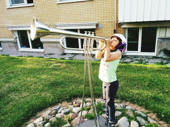 Girl with trumpet Girl Statue Trumpet EyeEm Selects Childhood Standing Architecture Grass