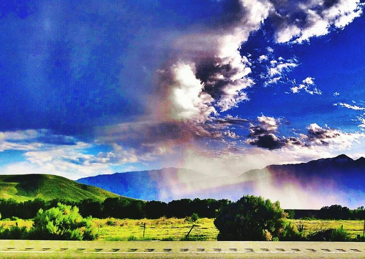 Raining Highwayphotography No People Raincloud Clouds And Sky Nopeople Green Nature Rolling Hills Green Valley Rain☔ Fallingrain View Of Mountains