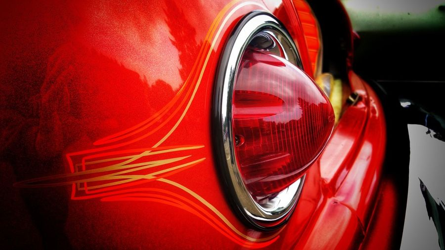 Vintage Tail light. Red! Pin Striping Round Ointed Triangle Red Classic Antique Car Auto Automotive Part Directional Signal Light Luminous Luminance Pattern Design Bold Timeless Red Land Vehicle Car Close-up Vintage Car Bumper Tail Light Vintage Collector's Car Vehicle Light Paint