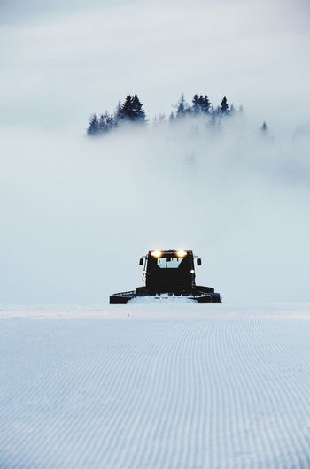 View of car on snow covered land