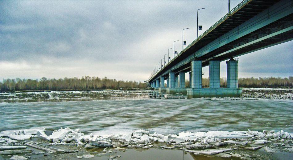Bridge Over Calm Lake Against Clouds