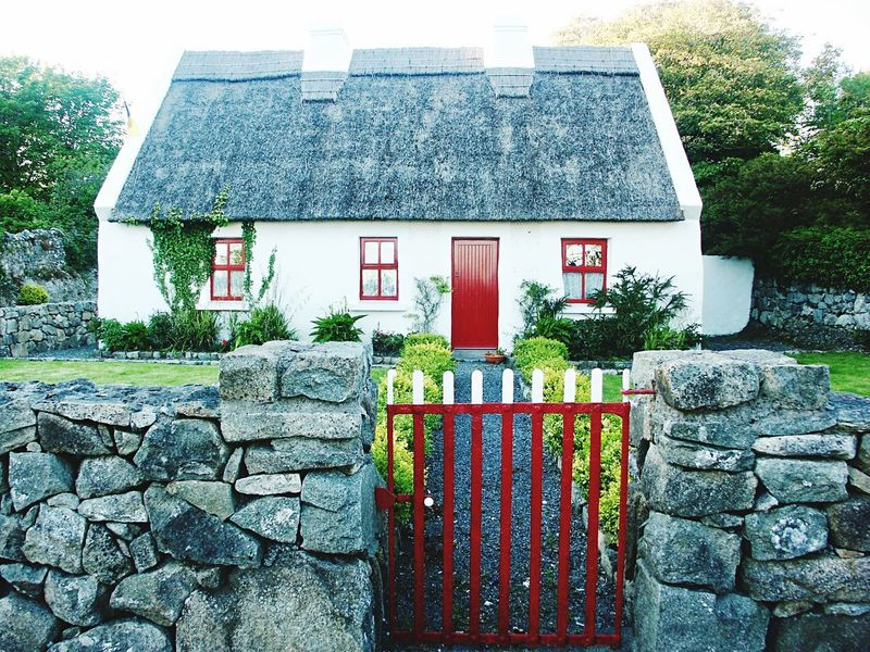 🍀 Irish cottage 🙌 Irish Cottage Cottage Red Gate Grass Red Windows Stone Wall Red Door Architecture House Built Structure Day Outdoors Building Exterior No People Sky