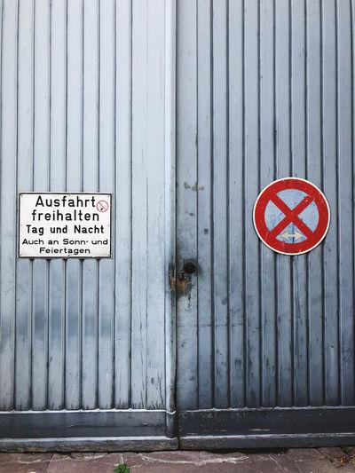 Warning sign on closed door