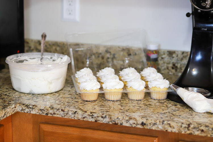 Cupcakes and icing in a home bakery