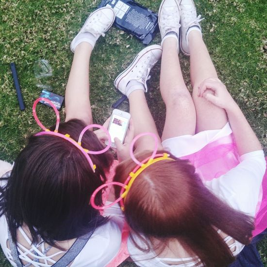High angle view of girl lying down on grass