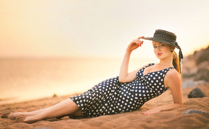 Portrait of young woman relaxing at beach