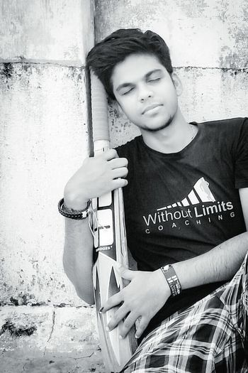 b/w pic !! Young Adult Young Men One Young Man Only Looking At Camera Waist Up Portrait Front View Young Women One Person Adults Only Three Quarter Length Indoors  Casual Clothing Lifestyles Real People Home Interior Leisure Activity People Adult Only Men Sport Bat Cricket Match Cricketer Welcome To Black EyeEmNewHere Long Goodbye