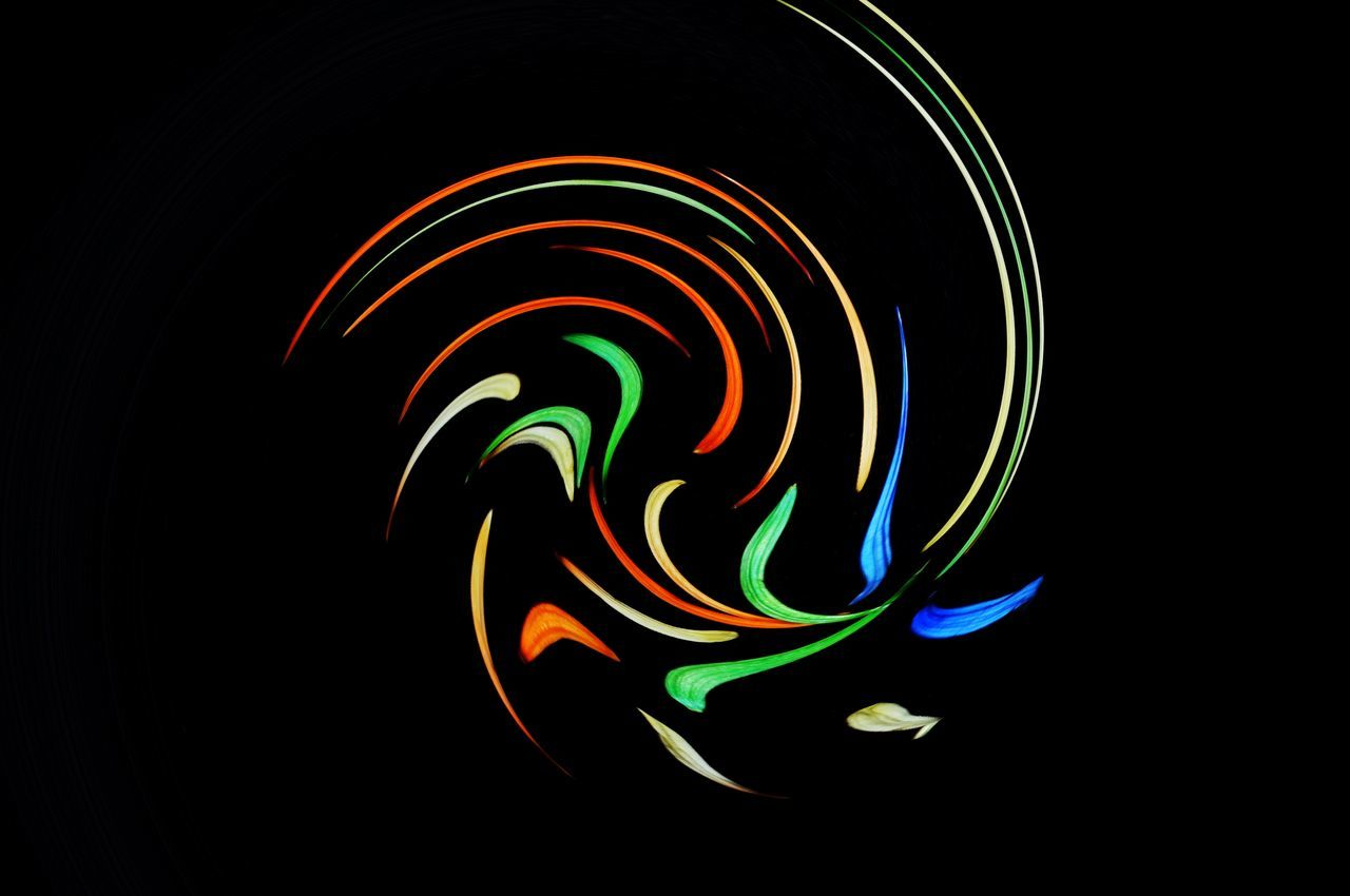 multi colored, studio shot, creativity, black background, night, illuminated, motion, long exposure, art and craft, no people, pattern, abstract, indoors, glowing, copy space, spiral, light painting, swirl, design, light trail