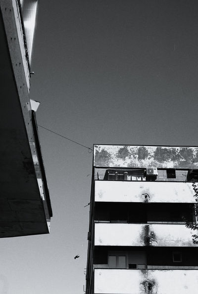 Analogue Photography Film Abandoned Architecture Building Building Exterior Built Structure City Clear Sky Copy Space Day Film Photography Ilford Ilford Pan F50 Low Angle View Nature No People Old Outdoors Residential District Roof Sky Sunlight Weathered Window