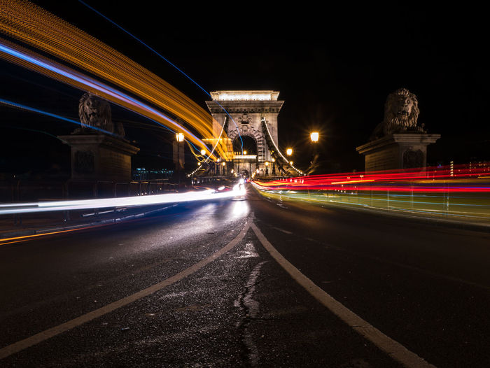 Budapest Hungary Architecture Blurred Motion Bridge - Man Made Structure Building Exterior Built Structure Chain Bridge City City Life Connection Direction Illuminated Light Trail Long Exposure Motion Night No People Outdoors Road Speed Street The Way Forward Transportation Travel Destinations