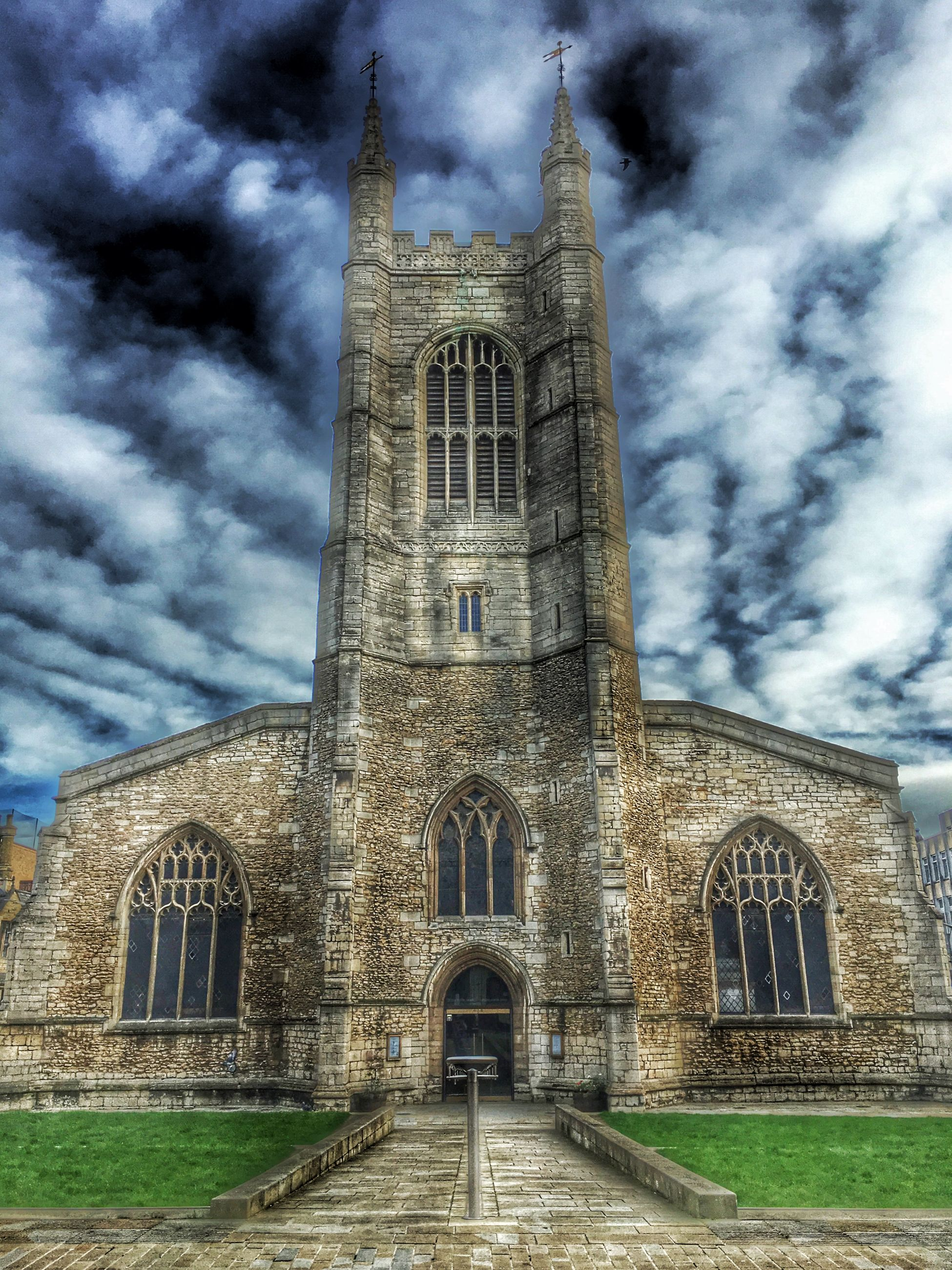 architecture, built structure, building exterior, sky, cloud - sky, religion, church, history, cloudy, low angle view, place of worship, old, spirituality, cloud, arch, cathedral, travel destinations, the past