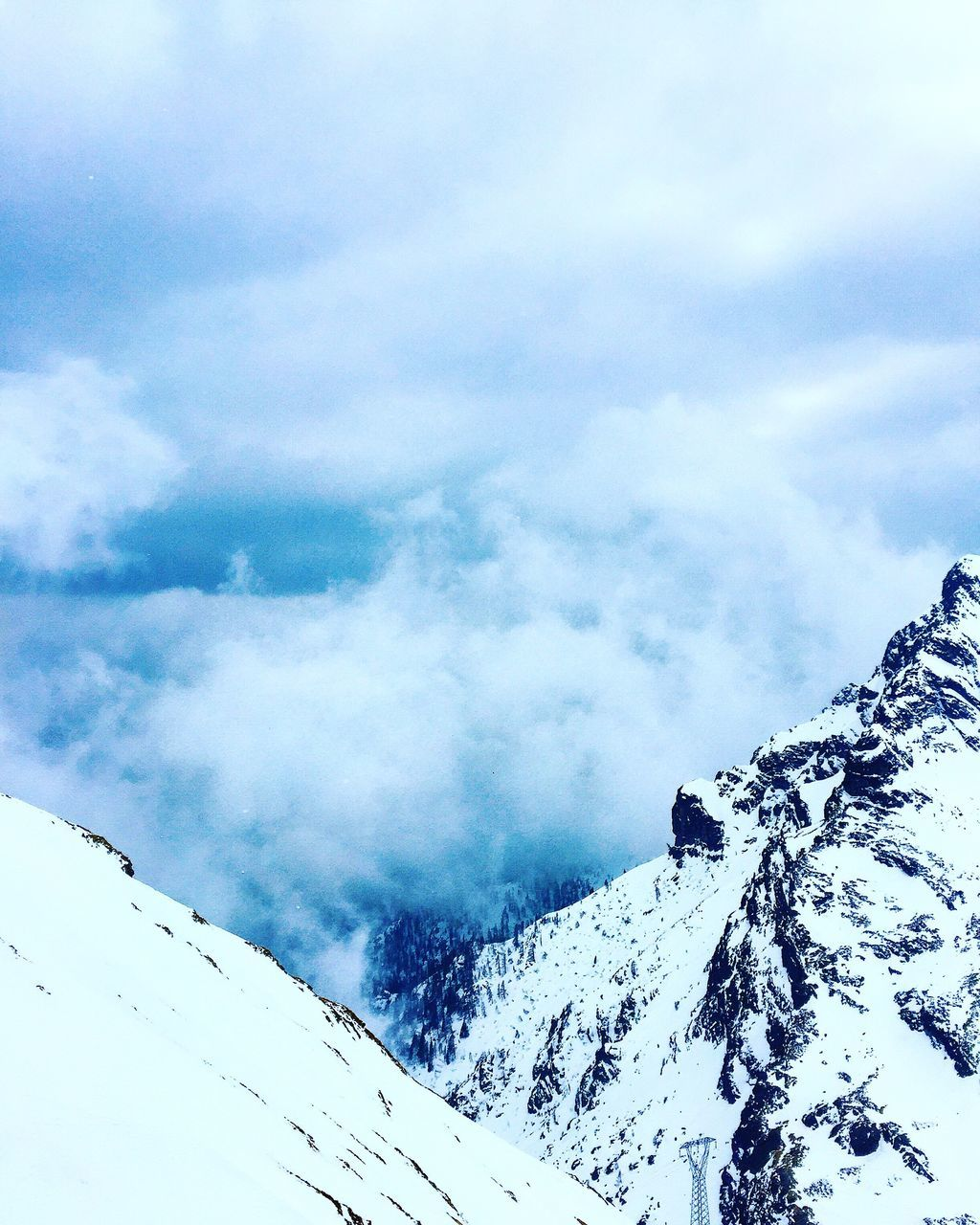 LOW ANGLE VIEW OF CLOUDY SKY And Snow Covered Mountains