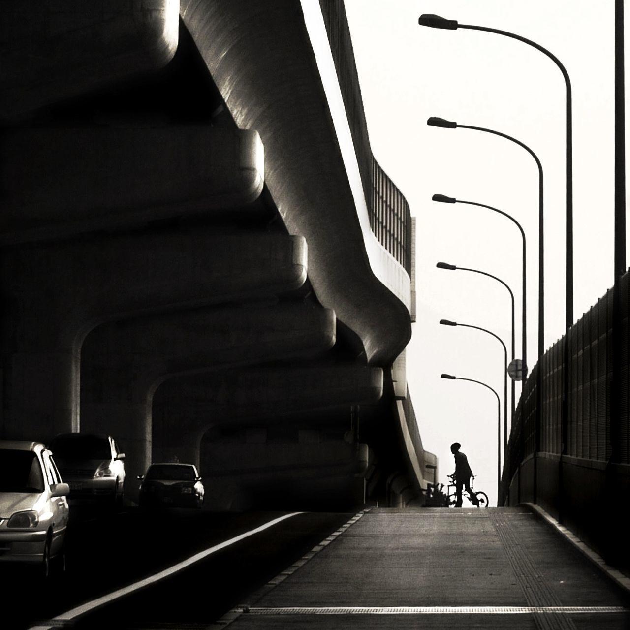 Cars highway by bridge in city