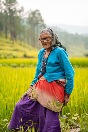 Portrait of senior woman wearing traditional clothing standing in farm