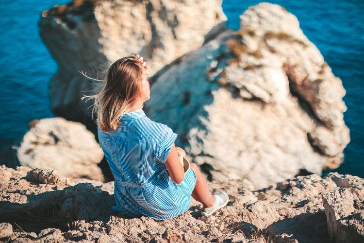 Rear view of girl looking at sea shore