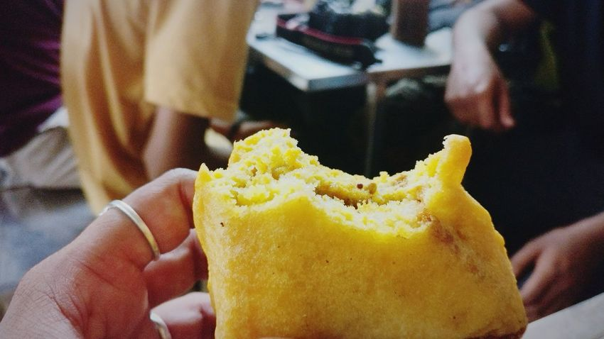 EyeEm Selects Human Body Part Human Hand One Person People Holding Close-up Lifestyles Yellow Real People Day Freshness Food Indian Food Indianphotography Indian Food At Its Best Indian Food! Foodphotography Food Styling Bread Pakoda