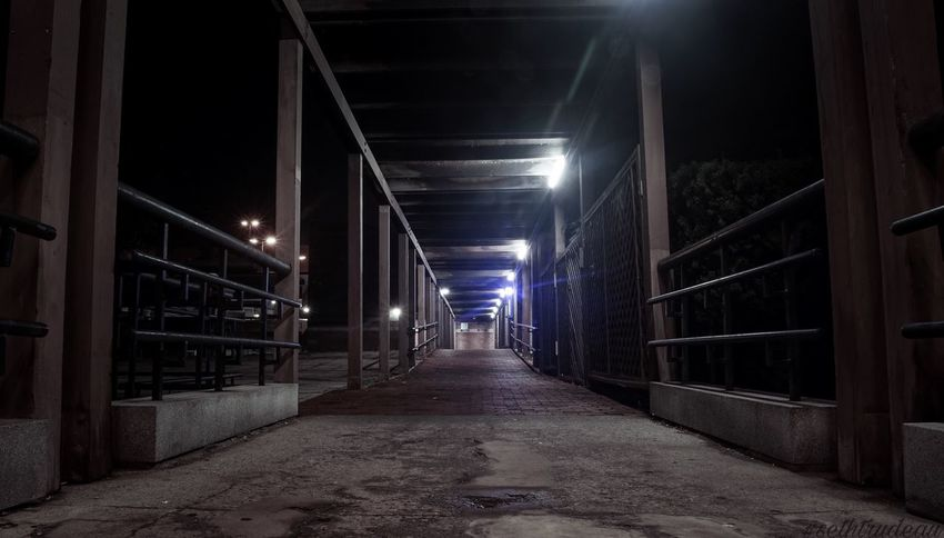 Walkway The Way Forward Illuminated Built Structure City Architecture Night Outdoors No People Sethtrudeau Photography Ghost Ghostly Haunted Errie Symmetrical Symmetry Symmetric Leading Lines Parallel Parallel Lines Lightattheendofthetunnel Walkway Dangerous Danger Scary