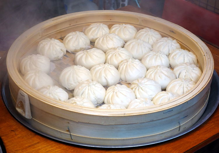 A bamboo steamer with Chinese steamed buns stuffed with meat Chinese Food Steamed Buns Baozi Bamboo Steamer Hot Food Ready To Eat Stuffing - Food Street Food Fresh Food Traditional Food Dough Shape Yeast Dough