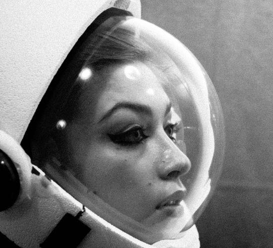 Close-up of woman wearing astronaut helmet