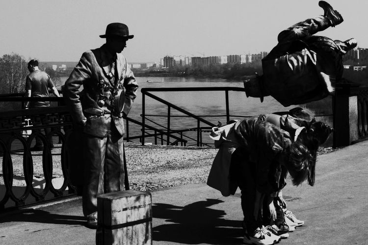 Retro Style Streetphoto_bw City Water Men Standing Sky