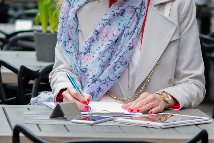 Hands of businesswoman working with documents. Business Lifestyle Sitting Student Tablet Woman Working Writing Attractive Businesswoman Cafe Document Education Female Finance Girl Internet Online  Paper Paperwork Phone Professional Signing Smartphone Technology