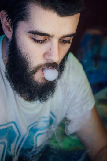 Close-up of man smoking hookah