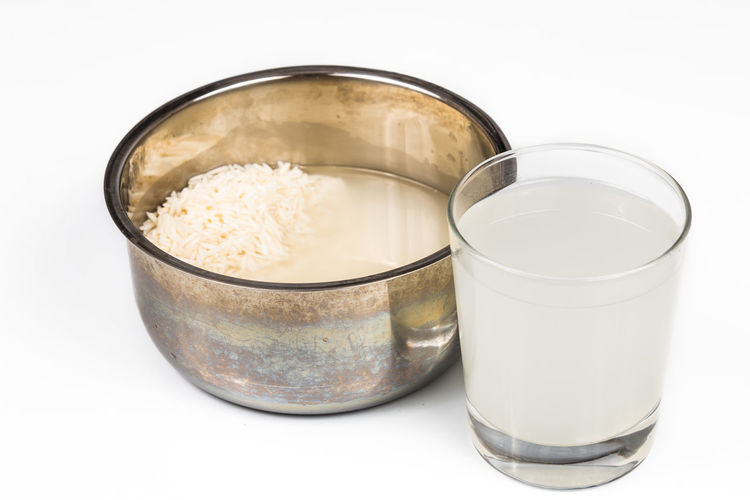 Water from rice rinse can be used as natural plant fertilizer Plant Rice Rice Paddy Fertilizer Food Food And Drink Healthy Eating Indoors  No People Rinse Still Life Studio Shot Wellbeing White Background