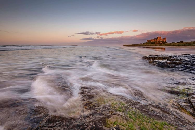 Tidal Shift Sea Scenics Sunset Tranquil Scene Idyllic Long Exposure Remote Seascape Castle Bamburgh TakeoverContrast Seaside Sea And Sky Beach And Sky Beach Photography Atmospheric Mood Coastline Northumberland Sea View Tidal Tranquility Tide Non-urban Scene Beauty In Nature Horizon Over Water