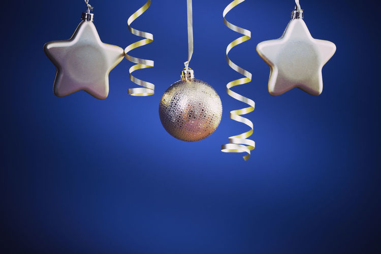 Low angle view of christmas decoration hanging against black background