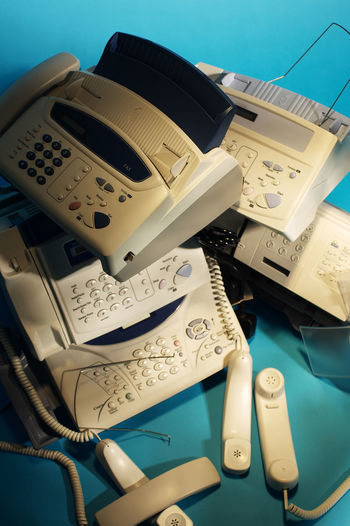 fax machine Business Fax Print Rubbish Blue Communication Connection Display Document Equipment Fax Machine Faxing  History Machinery No People Office Use Outdated Outdated Tech Phone Receiver Still Life Table Technology Telecommunications Equipment